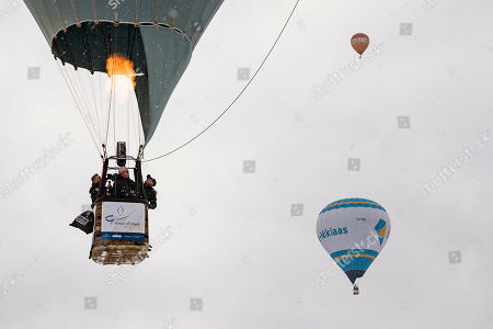 Stock Photo of Swiss balloonist Bertrand Piccard and British balloonist Brian Jones, the first to succeed a non-stop flight around the world in hot air balloons with the Breitling Orbiter 3 (L), take off with a copy of the Orbiter 3 during the 41st International Hot Air Balloon Festival in the skiing resort of Chateau d'Oex, in the Swiss Alps, 26 January 2019. Seventy balloons from 15 countries are taking part in the event held in the Swiss mountain resort from 26 January to 03 February.