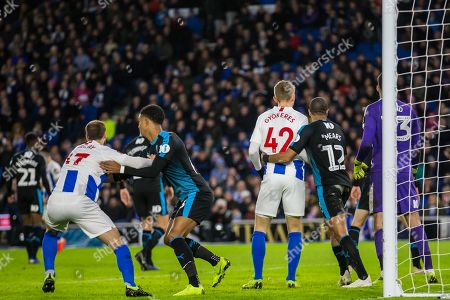 Glenn Murphy (Brighton) & Viktor Gyokeres (Brighton) in a hold at the goal mouth during the FA Cup fourth round match between Brighton and Hove Albion and West Bromwich Albion at the American Express Community Stadium, Brighton and Hove