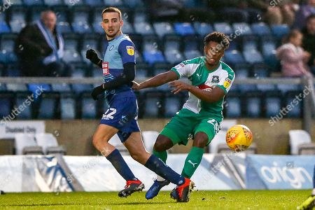 Plymouth Argyle defender Ashley Smith-Brown (23) and Wycombe Wanderers midfielder Nick Freeman(22) clash during the EFL Sky Bet League 1 match between Wycombe Wanderers and Plymouth Argyle at Adams Park, High Wycombe