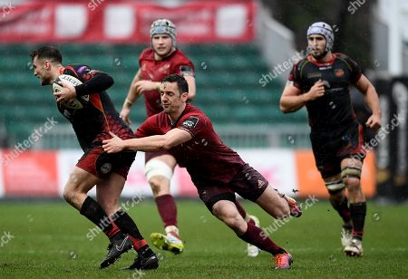 Dragons vs Munster. Munster's Darren Sweetnam tackles Josh Lewis of Dragons