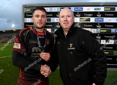 Dragons vs Munster. Dragons' Josh Lewis receives the man of the match medal from Jamie Blake on behalf of Guinness