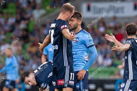Melbourne Victory forward Ola Toivonen (11) and Sydney FC midfielder Milos Ninkovic (10) have a confrontation
