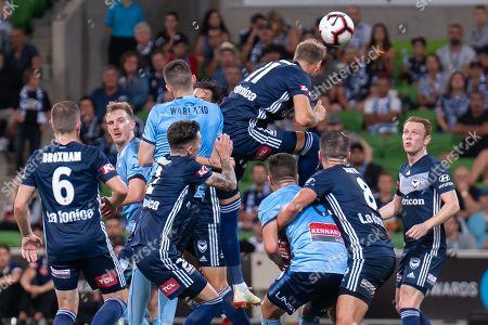 Melbourne Victory forward Ola Toivonen (11) heads the ball
