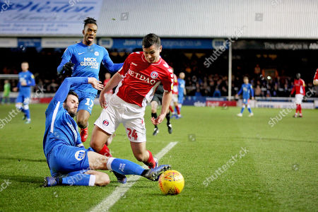 Peterborough Utd defender Jason Naismith (2) is adjudged to have fouled Charlton midfielder Josh Cullen (24) and a penalty was given during the EFL Sky Bet League 1 match between Peterborough United and Charlton Athletic at London Road, Peterborough