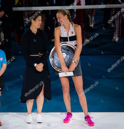 Petra Kvitova of the Czech Republic chats with Li Na during the trophy ceremony after the final of the 2019 Australian Open Grand Slam tennis tournament