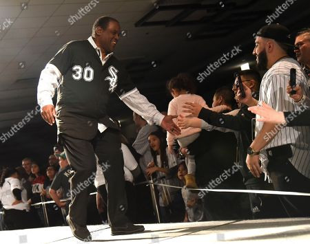 Former Chicago White Sox player Tim Raines is introduced to the fans during the baseball team's convention, in Chicago