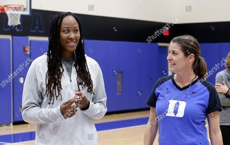"""Stock Picture of Joanne P. McCallie, Chamique Holdsclaw. Duke women's basketball coach Joanne P. McCallie, right, listens as former Tennessee player Chamique Holdsclaw speaks to Duke players during the team's NCAA college basketball practice in Durham, N.C., . Coach McCallie and Duke hope to erase the stigma of mental health issues with their inaugural """"Mental Wealth Day"""