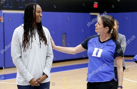 """Joanne P. McCallie, Chamique Holdsclaw. Duke women's basketball coach Joanne P. McCallie, right, and former Tennessee player Chamique Holdsclaw speak to Duke players during the team's NCAA college basketball practice in Durham, N.C., . Coach McCallie and Duke hope to erase the stigma of mental health issues with their inaugural """"Mental Wealth Day"""