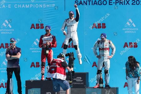 British driver Sam Bird of the team Envision Virgin Racing (C) celebrates his victory with the second placed Pascal Wehrlein (Germany) of the Mahindra Racing team (L) and the third Daniel Abt (Germany) Audi Sport ABT Schaeffler (R) in the Santiago Grand Prix of Formula E, at the O'Higgins Park Circuit, in Santiago, Chile, 26 January 2019. The O'Higgins Park in the center of Santiago de Chile was transformed into a racing circuit for the 22 drivers participating in the third grand prize of the Formula E world championship.