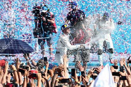 British driver Sam Bird of the team Envision Virgin Racing (C) celebrates his victory in the Santiago Grand Prix of Formula E, at the O'Higgins Park Circuit, in Santiago, Chile, 26 January 2019. The O'Higgins Park in the center of Santiago de Chile was transformed into a racing circuit for the 22 drivers participating in the third grand prize of the Formula E world championship.