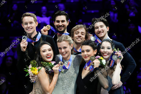 Madison Chock, bottom left, and Evan Bates, top left, second place; Madison Hubbell, bottom second from left, and Zachary Donohue, top second from left, U.S. ice dancing champions; Kaitlin Hawayek, bottom second from right, and Jean-Luc Baker, top second from right, third place; and Lorraine McNamara, bottom right, and Quinn Carpenter, top left, fourth place; pose with their medals at the U.S. Figure Skating Championships, in Detroit
