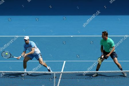 Henri Kontinen of Finland (R) and John Peers of Australia (L) in action against Pierre-Hugues Herbert of France and Nicolas Mahut of France in the men's doubles final on day fourteen of the Australian Open tennis tournament in Melbourne, Australia, 27 January 2019.