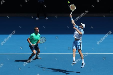 Henri Kontinen (L) of Finland and John Peers (R) of Australia in action against Pierre-Hugues Herbert of France and Nicolas Mahut of France in the men's doubles final on day fourteen of the Australian Open tennis tournament in Melbourne, Australia, 27 January 2019.