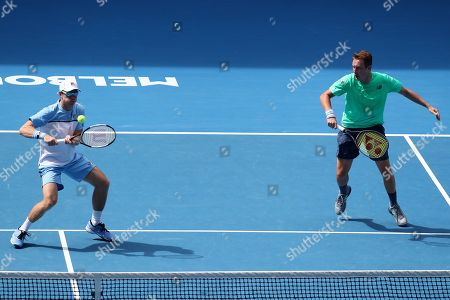 Henri Kontinen (R) of Finland and John Peers (L) of Australia in action against Pierre-Hugues Herbert of France and Nicolas Mahut of France in the men's doubles final on day fourteen of the Australian Open tennis tournament in Melbourne, Australia, 27 January 2019.