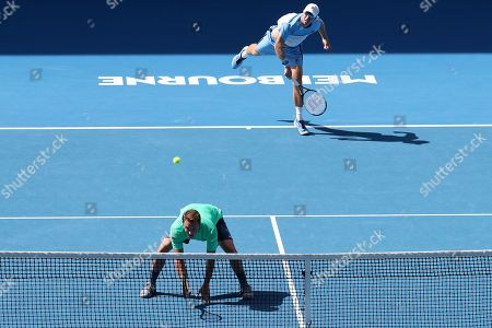 Henri Kontinen (bottom) of Finland and John Peers (top) of Australia in action against Pierre-Hugues Herbert of France and Nicolas Mahut of France in the men's doubles final on day fourteen of the Australian Open tennis tournament in Melbourne, Australia, 27 January 2019.