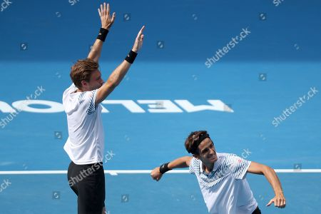 Pierre-Hugues Herbert (R) of France and Nicolas Mahut (L) of France celebrate after defeating Henri Kontinen of Finland and John Peers of Australia in the men's doubles final on day fourteen of the Australian Open tennis tournament in Melbourne, Australia, 27 January 2019.