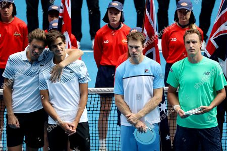 (L-R) Nicolas Mahut of France, Pierre-Hugues Herbert of France, John Peers of Australia and Henri Kontinen of Finland pose for a photograph during the trophy presentation for men's doubles final on day fourteen of the Australian Open tennis tournament in Melbourne, Australia, 27 January 2019.