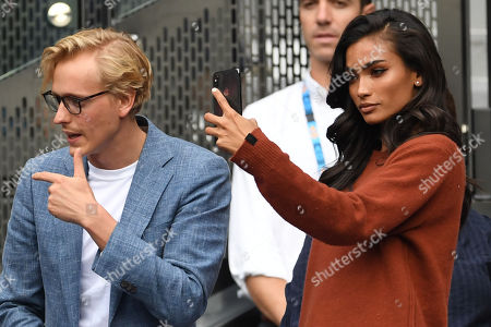 Victoria's Secret model Kelly Gale (R) and boyfriend Johannes Jarl (L) are seen in the crowd before the start of the men's singles final between Novak Djokovic of Serbia and Rafael Nadal of Spain at the Australian Open Grand Slam tennis tournament in Melbourne, Victoria, Australia, 27 January 2019.