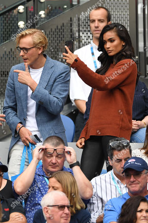 Victoria's Secret model Kelly Gale (R, top) and boyfriend Johannes Jarl (L) are seen in the crowd before the start of the men's singles final between Novak Djokovic of Serbia and Rafael Nadal of Spain at the Australian Open Grand Slam tennis tournament in Melbourne, Victoria, Australia, 27 January 2019.
