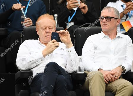 Executive Chairman of Visy Industries, Anthony Pratt (L) is seen in the crowd before the start of the men's singles final between Novak Djokovic of Serbia and Rafael Nadal of Spain at the Australian Open Grand Slam tennis tournament in Melbourne, Victoria, Australia, 27 January 2019.