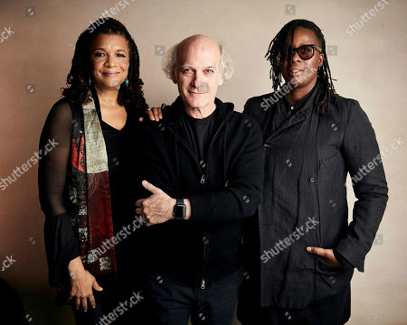 """Stock Image of Kathryn Bostic, Timothy Greenfield-Sanders, Mickalene Thomas. Composer Kathryn Bostic, from left, director Timothy Greenfield-Sanders, and Mickalene Thomas pose for a portrait to promote the film """"Toni Morrison: The Pieces I Am"""" at the Salesforce Music Lodge during the Sundance Film Festival, in Park City, Utah"""