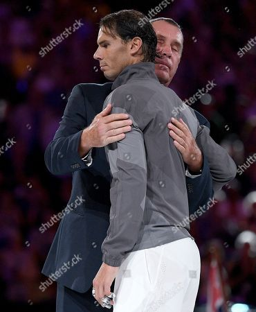 Spain's Rafael Nadal, left, is embraced by Ivan Lendl after losing to Serbia's Novak Djokovic in the men's singles final at the Australian Open tennis championships in Melbourne, Australia