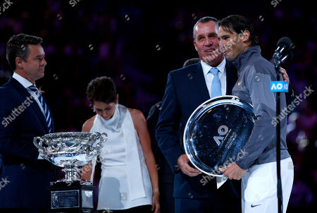 Stock Photo of Rafael Nadal of Spain receives the runners up trophy from Ivan Lendl
