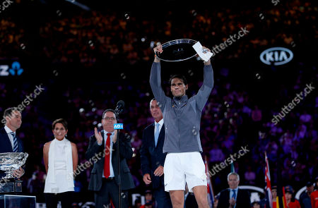 Stock Image of Rafael Nadal of Spain receives the runners up trophy from Ivan Lendl