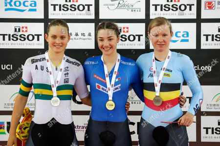 Martina Fidanza, Alex Martin-Wallace, Lisa Kullmer. Gold medalist Italy's Martina Fidanza, center, silver medalist Australia's Alex Martin-Wallace, left, and bronze medalist Germany's Lisa Kullmer celebrate on podium after winning the final of Women's Scratch Race at the World Track Cycling championships in Hong Kong, on