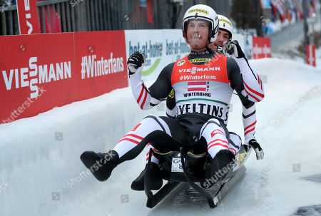 Stock Photo of Thomas Steu and Lorenz Koller celebrate the second place in the finish area during the Luge World Championships Team Relay Race in Winterberg, Germany, 27 January 2019.