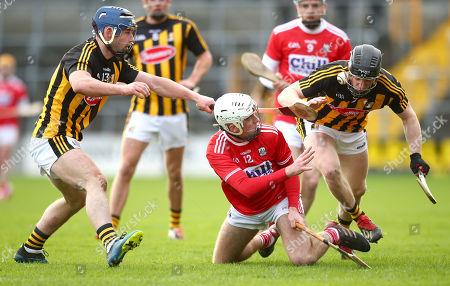 Kilkenny vs Cork. Kilkenny's Billy Ryan and Enda Morrissey tackle Luke Meade of Cork