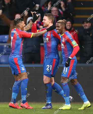Connor Wickham of Crystal Palace celebrates scoring the opening goal with team-mates  Patrick van Aanholt  of Crystal Palace and  Wilfried Zaha of Crystal Palace