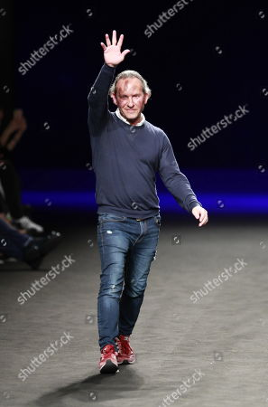 Stock Picture of Spanish designer Custo Dalmau appears on the catwalk after the presentation of his collection for his label Custo Barcelona at the Mercedes-Benz Fashion Week in Madrid, Spain, 27 January 2019. The MBFWM Fall-Winter 2019/20 runs from 24 to 29 January.