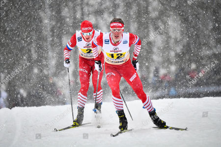 Andrey Melnichenko (L) and Denis Spitsov (R), both of Russia, in action during the men's 4x7.5km Relay race of the FIS Cross Country Skiing World Cup in Ulricehamn, Sweden, 27 January 2019.