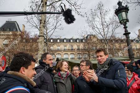 French essayist and founder of citizen movement 'Place publique' Raphael Glucksmann (2-L) speaks with French Green Party (EELV) leader Yannick Jadot (R) as they attend the 'Agora for the climate' protest in Paris, France, 27 January 2019. Actions are planned in more than 90 cities to promote green solutions and make 2019 the year of the climate.