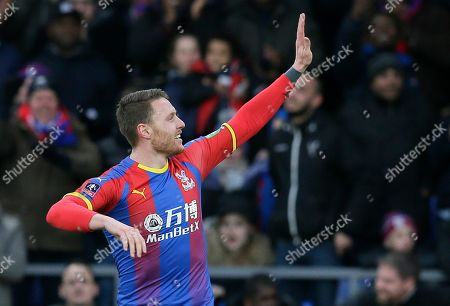 Crystal Palace's Connor Wickham celebrates after scoring the opening goal during an English FA Cup fourth round soccer match between Crystal Palace and Tottenham Hotspur at Selhurst Park in London