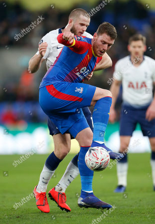 Connor Wickham of Crystal Palace shields the ball from Eric Dier of Tottenham Hotspur