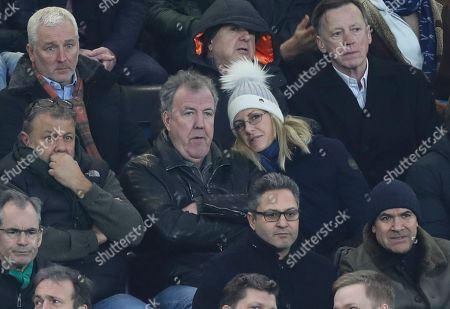 Stock Image of Chelsea fan Jeremy Clarkson sits with his girlfriend Lisa Hogan