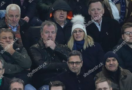 Stock Photo of Chelsea fan Jeremy Clarkson sits with his girlfriend Lisa Hogan