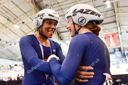 Stock Picture of Shanaze Reade and Blaine Ridge-Davis celebrate winning gold in the Women's Team Sprint.