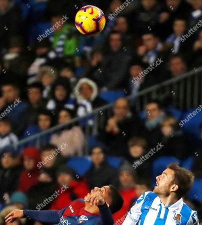 Real Sociedad's midfielder Asier Illarramendi (R) in action against Huesca's forward Cucho Hernandez (L) during the Spanish La Liga soccer match between Real Sociedad and SD Huesca in San Sebastian, Spain, 27 January 2019.