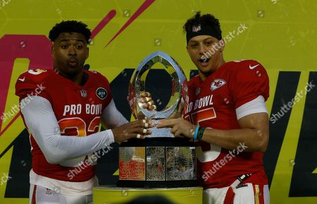 AFC safety Jamal Adams (33), of the New York Jets, and AFC quarterback Patrick Mahomes (15), of the Kansas City Chiefs, after being named MVP's during the NFL Pro Bowl football game, in Orlando, Fla