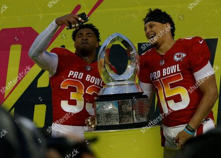 Stock Picture of AFC safety Jamal Adams (33), of the New York Jets, left, and AFC quarterback Patrick Mahomes (15), of the Kansas City Chiefs, pose for a photo after being named MVP's during the NFL Pro Bowl football game, in Orlando, Fla