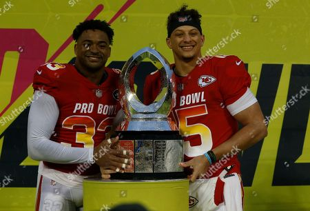 Stock Image of AFC safety Jamal Adams (33), of the New York Jets, and AFC quarterback Patrick Mahomes (15), of the Kansas City Chiefs, after being named MVP's during the NFL Pro Bowl football game, in Orlando, Fla