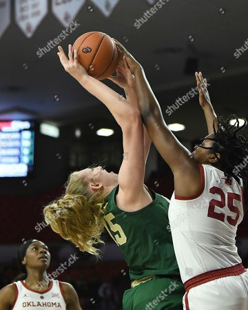 Oklahoma guard Madi Williams (25) blocks a shot by Baylor forward Lauren Cox (15) in the second half of an NCAA college basketball game in Norman, Okla