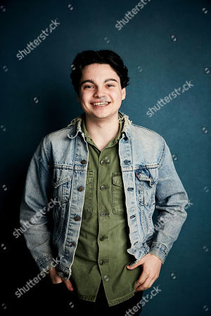 """Max Burkholder poses for a portrait to promote the film """"Imaginary Order"""" at the Salesforce Music Lodge during the Sundance Film Festival, in Park City, Utah"""