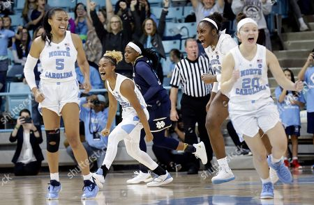 Stephanie Watts, Paris Kea, Janelle Bailey, Leah Church. North Carolina's Stephanie Watts (5), Paris Kea, Janelle Bailey and Leah Church (20) celebrate following their team's 78-73 win over Notre Dame in an NCAA college basketball game in Chapel Hill, N.C