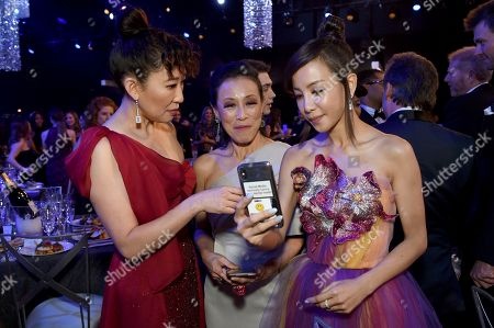 Sandra Oh, Tan Kheng Hua, Fiona Xie. Sandra Oh, from left, Tan Kheng Hua, and Fiona Xie attend the 25th annual Screen Actors Guild Awards at the Shrine Auditorium & Expo Hall, in Los Angeles