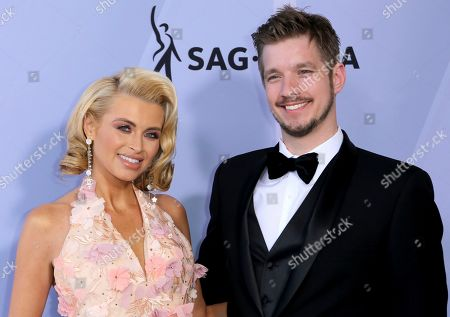 Lindsay Davis, Aki Balogh. Lindsay Davis, left, and Aki Balogh arrive at the 25th annual Screen Actors Guild Awards at the Shrine Auditorium & Expo Hall, in Los Angeles