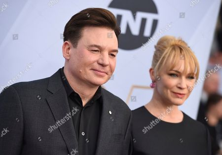 Mike Myers, Kelly Tisdale. Mike Myers, left, and Kelly Tisdale arrive at the 25th annual Screen Actors Guild Awards at the Shrine Auditorium & Expo Hall, in Los Angeles